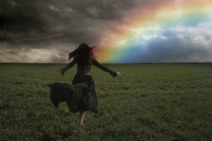woman running to rainbow
