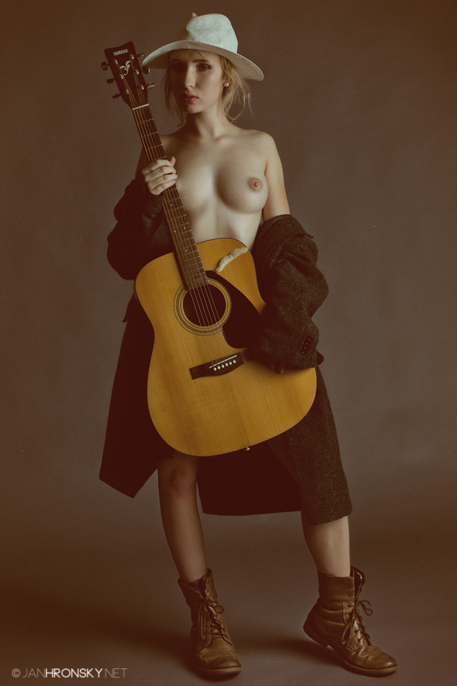 While Her Guitar Gently Weeps by zlty-dodo