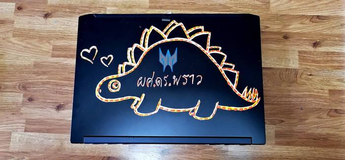 Back of Laptop., the Orange Dinosaur Stegosuarus