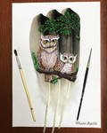 Owls. Painting on a feather
