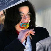 MJ with lollipop by QueenOfCelebrities94