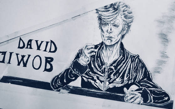 Bowie lighting a cig