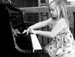 My sweetie girl on the piano April 2012