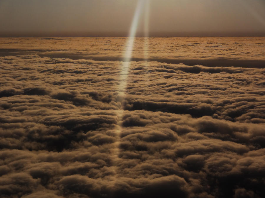Sunrise Clouds 1 - taken from an airplane- by IoannisCleary