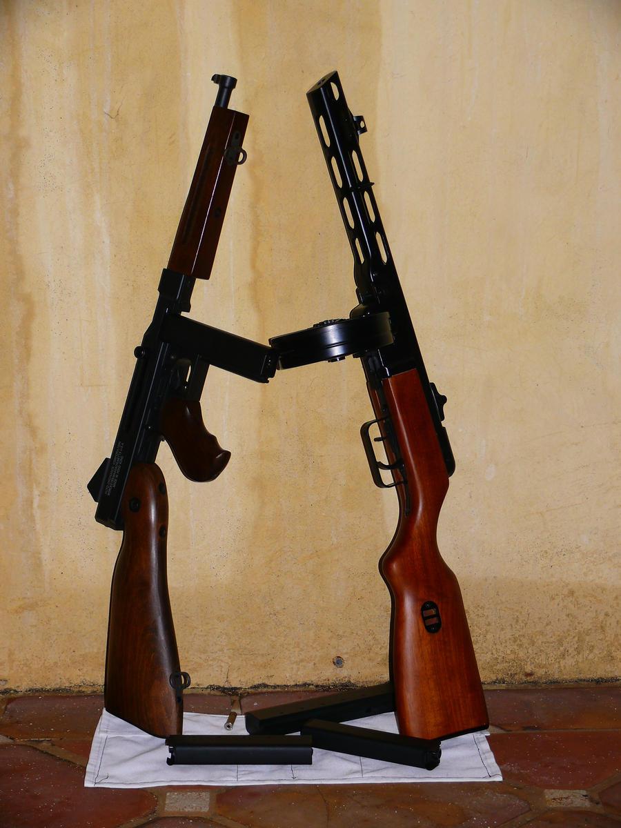 PPSH 41 - El arma que gano la Gran Guerra Patria Ppsh_41_vs__m1a1_thompson_by_shadowspetsnaz-d5pro06