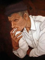 viel homme fumant sa cigarette
