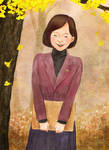 A girl in front of a ginkgo tree