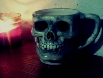 Candlelit skull cup by Morbid-Corpse
