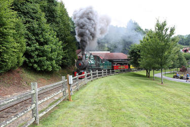 Black coal smoke on big toy train