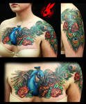 Peacock Feather Chest Tattoo by Jackie Rabbit