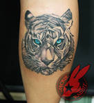 Geometric tiger Portrait Tattoo by Jackie Rabbit
