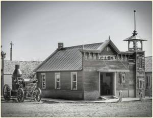 Horse Drawn Fireman's Wagon Beside The Fire House