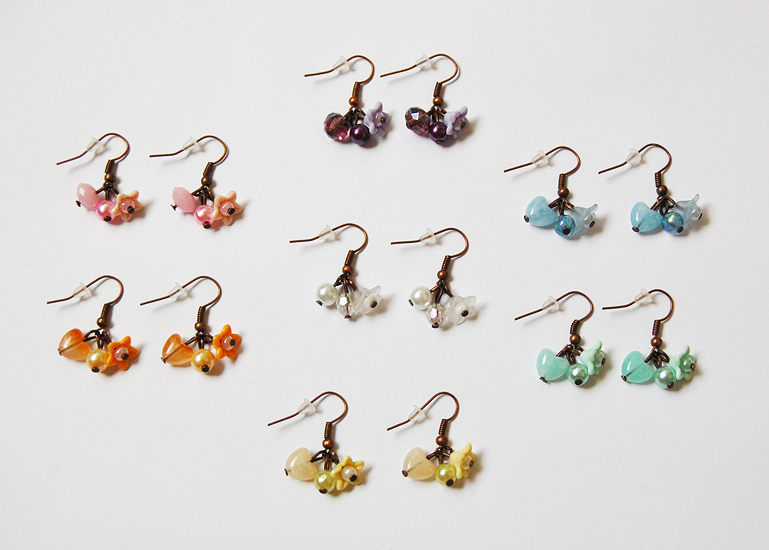 charm earrings by Crimefish