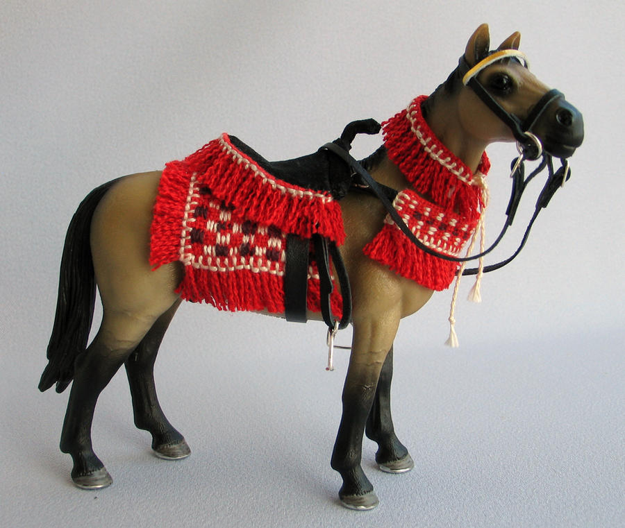 http://fc04.deviantart.net/fs71/i/2011/071/7/b/akhal_teke_horse_schleich_by_mojcaj-d3b9t6x.jpg