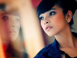 Intan with Her Reflection by maximaxi13