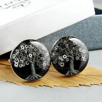 Silver cufflinks with trees made of watch parts.