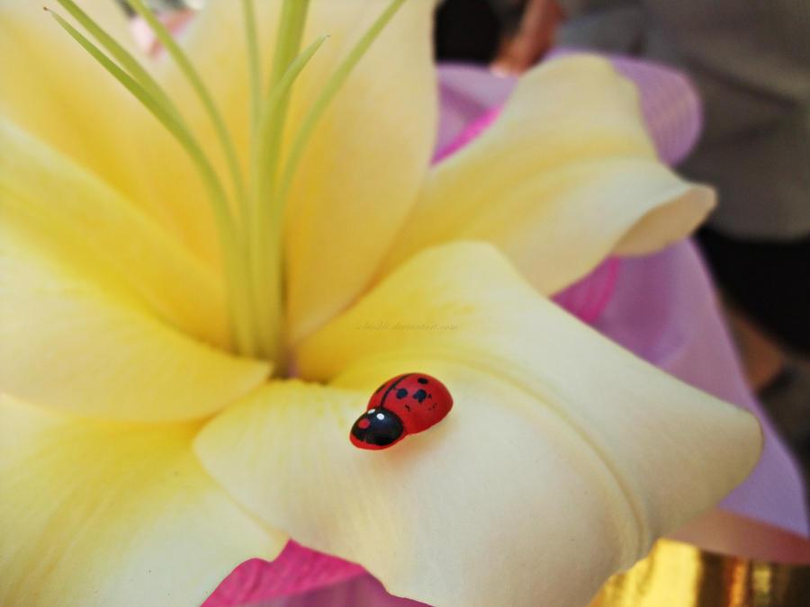 ladybug yellow flower by SoBiEsKii