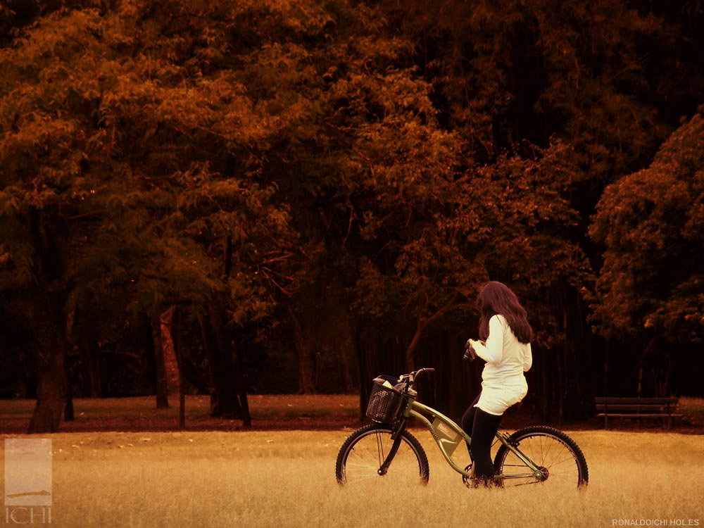 Girl with bicycle in park by ronaldoichi
