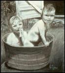2 kids in a bucket