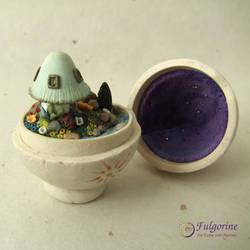 Polymer clay fairy garden inside an Easter egg