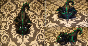 Black and Green Playful Dragon