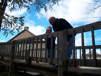 Father and Daughter on Bridge by scrawnyfella