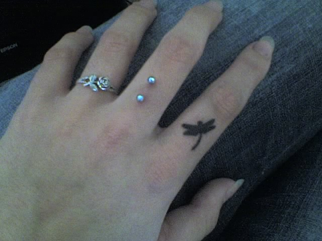Retsis tattoo on my finger - dragonfly tattoo