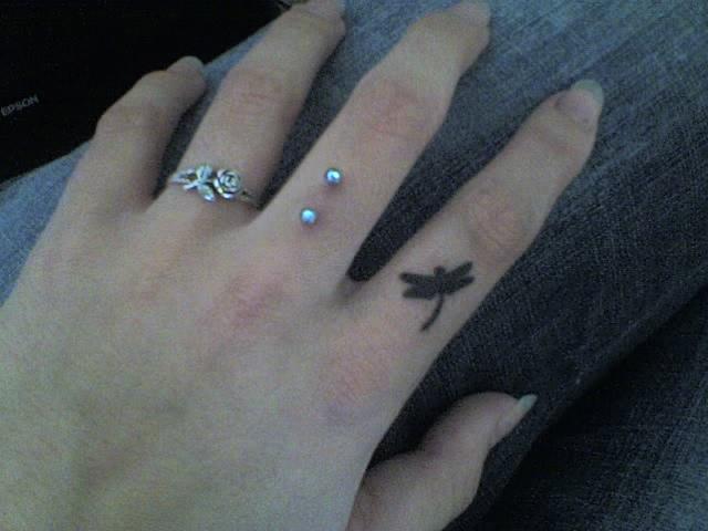Retsis tattoo on my finger by happyhippybassist