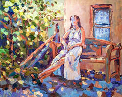 Woman sitting on a Garden Bench
