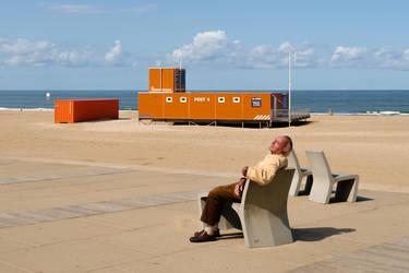 Man enjoying the Sun on the Beach of Scheveningen
