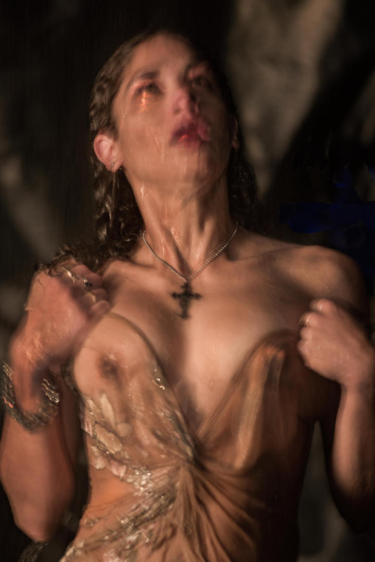 Wet Woman With Crucifix Looking Up by Laurence2