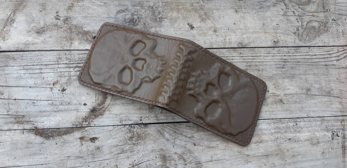 Creepy spine and skulls leather molded wallet