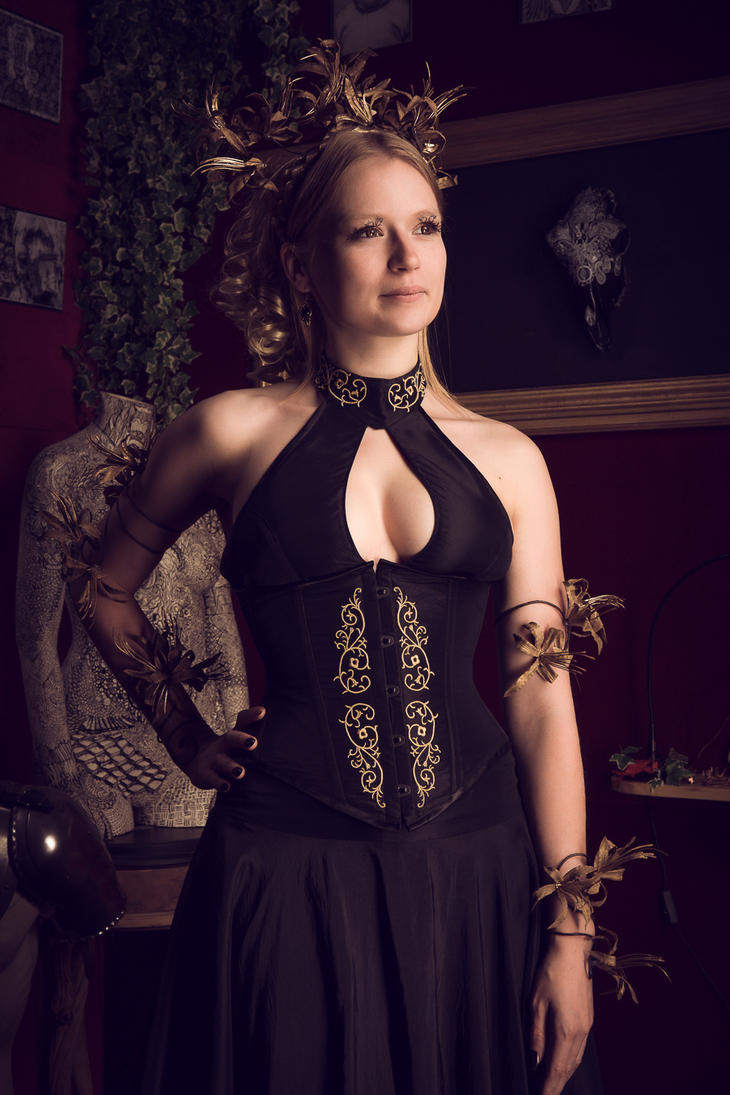 Black corset dress with golden embroidery by Esaikha