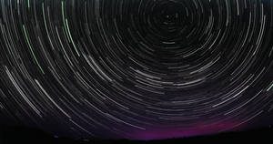 Star trail with a little bit of aurora borealis