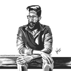 Guy With A Beard Sitting On A Bench