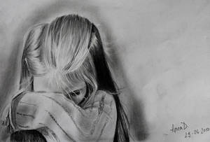 Sad little girl drawing