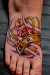 Crown on foot tattoo