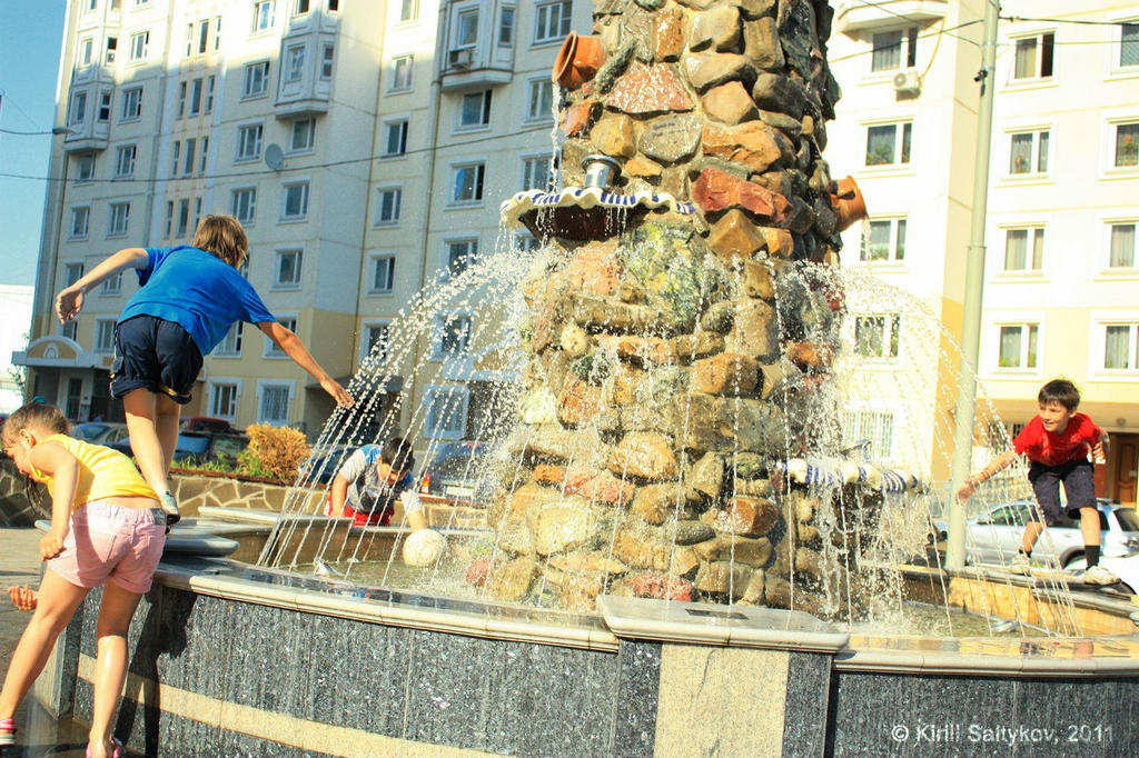 Childrens playing with fountain by skv1991