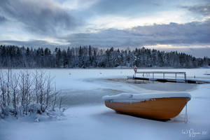 A rowboat in snow by Pajunen