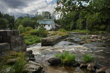 Abandoned house by the river by Pajunen