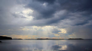 Sunrays above the lake