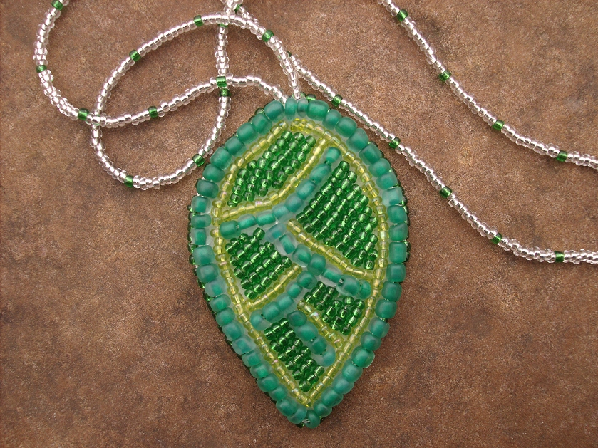 Bead embroidered leaf necklace by peachpodhandmade on