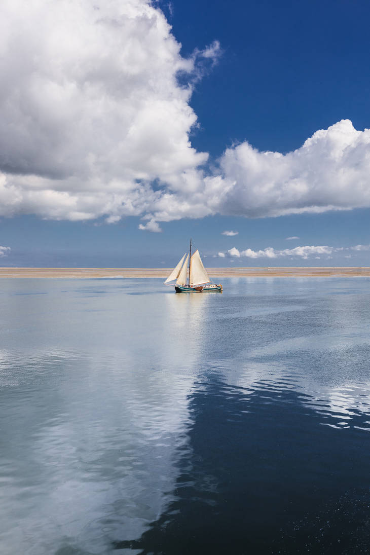 sailing boat between clouds