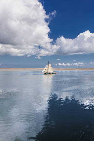 sailing boat between clouds by StefanPrech