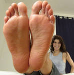 Marisa Tomei holding her feet up