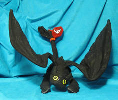 Toothless with Red Tail Fin by stephanielynn