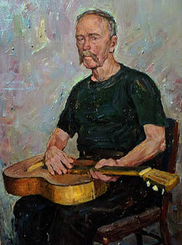 Old man with a guitar