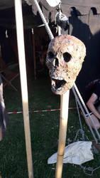 impaled rotting skull