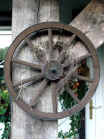 a wooden wheel by Mortifiera