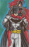 Batwoman riding on Batman's Back